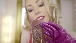Sexy and busty mature Candy May in gloves fetish handjob