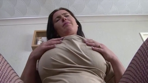 Ebony MILF demonstrates natural boobs