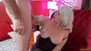 Young MILF in stockings cock sucking